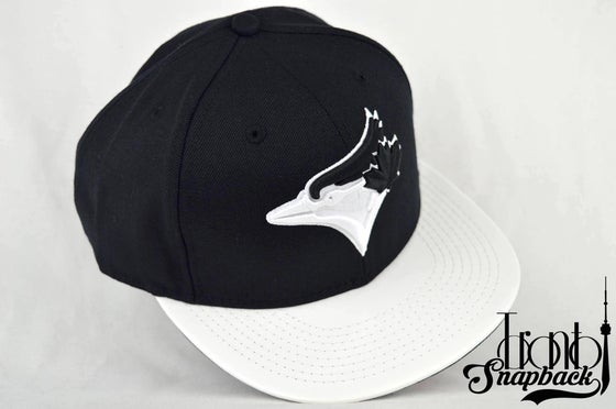 Image of TORONTO BLUE JAYS CUSTOM BLACK & WHITE LEATHER NEW ERA SNAPBACK CAP