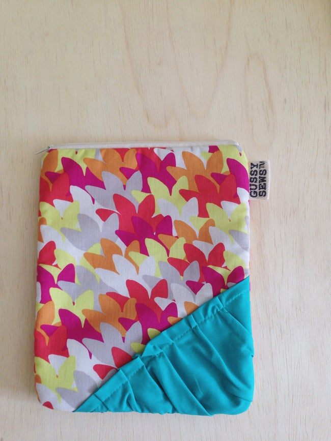 Image of fuschia leaves with teal ruffle, iPad Air pouch