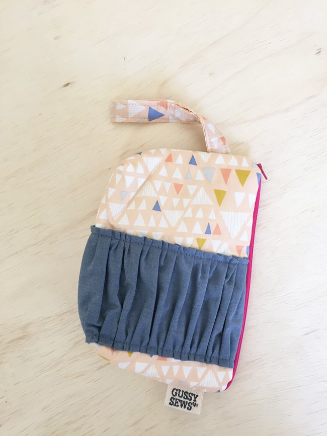 Image of triangles with chambray ruffle, wristlet