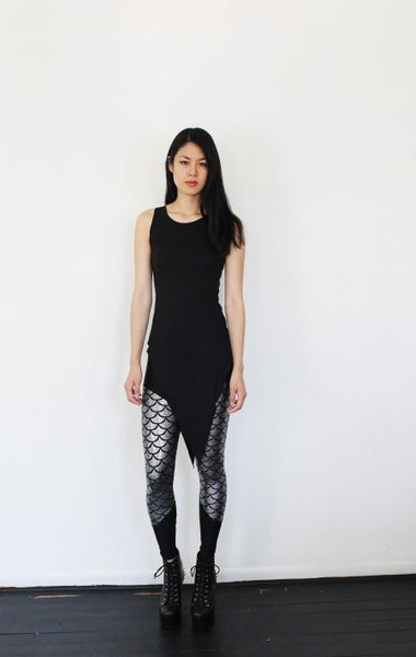 Image of Pointy tunic with faux leather side straps