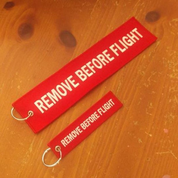Image of Giant Remove Before Flight Tag
