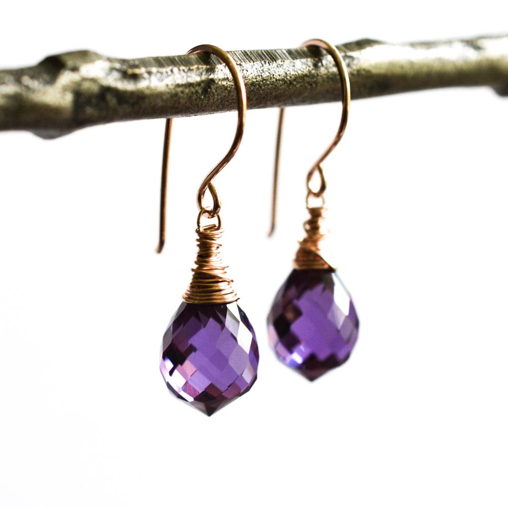 Image of Lab created color change sapphire earrings rose gold