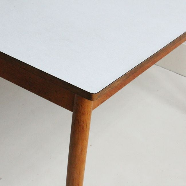 Image of Formica table with wooden legs