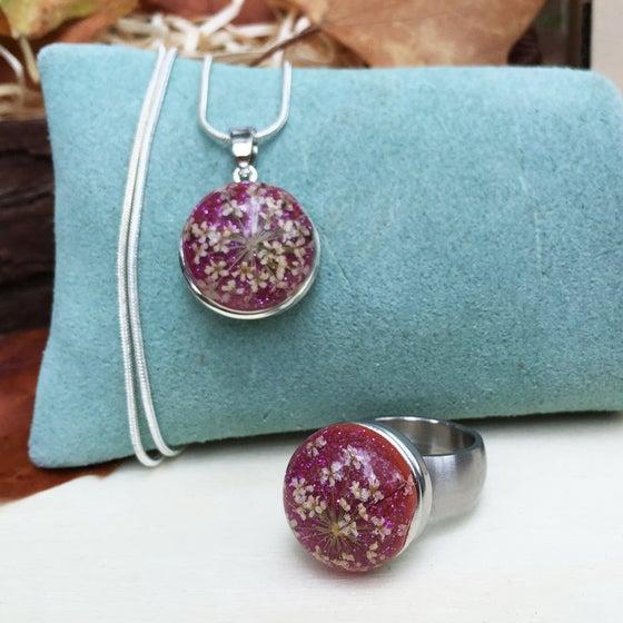 Image of Conjunto Acero de Anillo y Colgante Flores Rosa