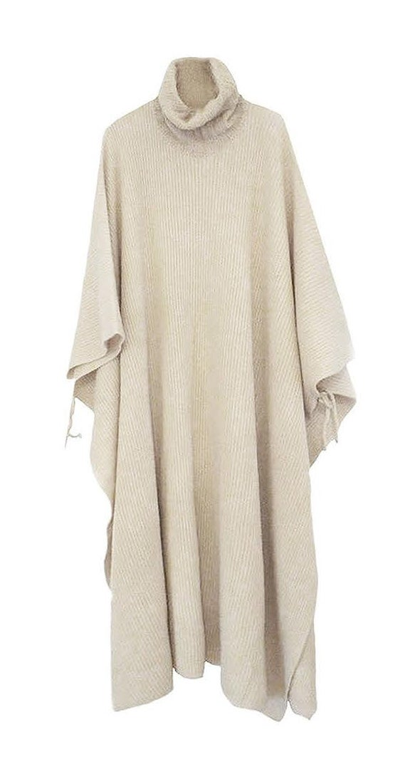 Image of FLOOR LENGTH RIB PONCHO AVAILABLE IN CHAMPAGNE, BLACK AND PALE APRICOT