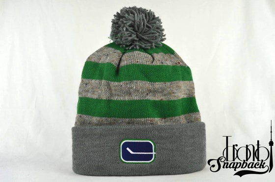 Image of VANCOUVER CANUCKS STRIPE LOGO NBA MITCHELL & NESS BEANIE