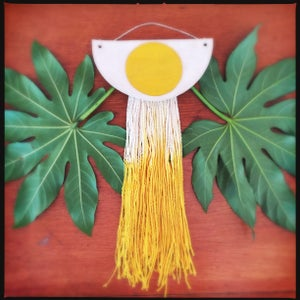 Image of Sun egg with runny rays wall hanging