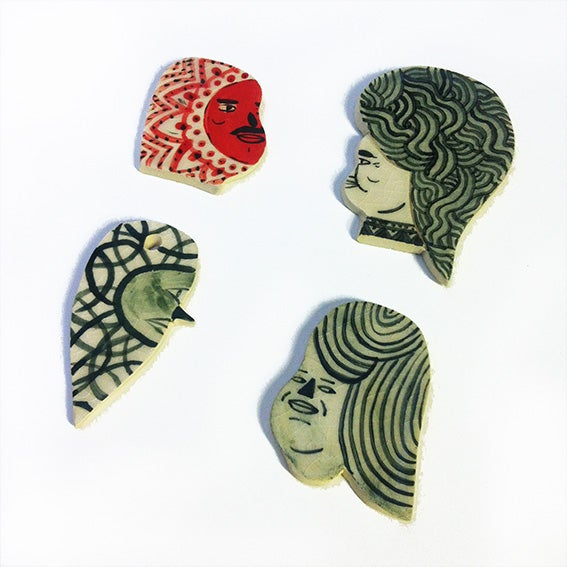 Image of Medium Sized Ceramic heads (1 red 3 green)
