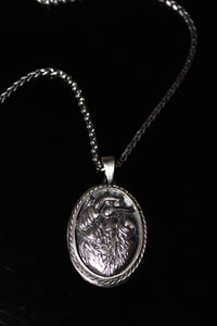 Image of Organic heart medallion in silver on steel chain