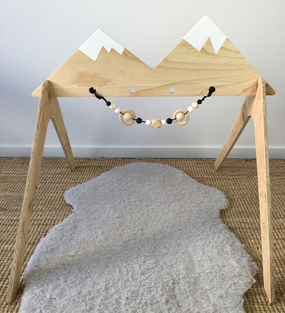 Image of Wooden Activity Gym - Snow Capped Mountain Range