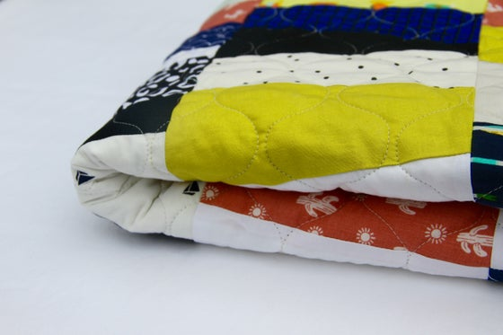 Image of Toucan Patchwork Quilt