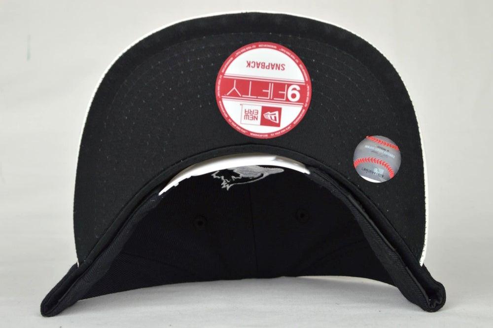 Image of TORONTO BLUE JAYS CUSTOM BLACK & WHITE LEATHER NEW ERA SNAPBACK CAP