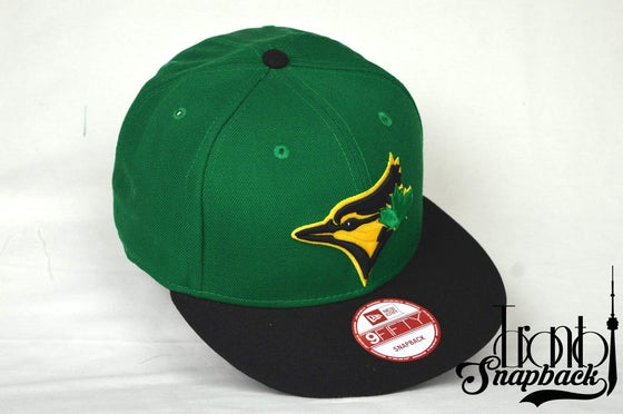 Image of TORONTO BLUE JAYS BLACK, GREEN & YELLOW NEW ERA SNAPBACK