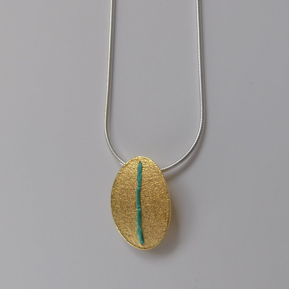 Image of Sewn Up oval necklace