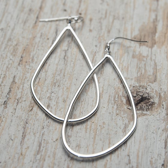 Image of wing outline earrings