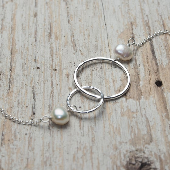 Image of mother daughter intertwined circles necklace