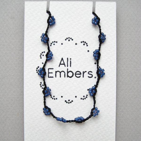 Image of Iris Blue and Black Tie On Bracelet