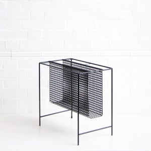 Image of Black metal magazine rack