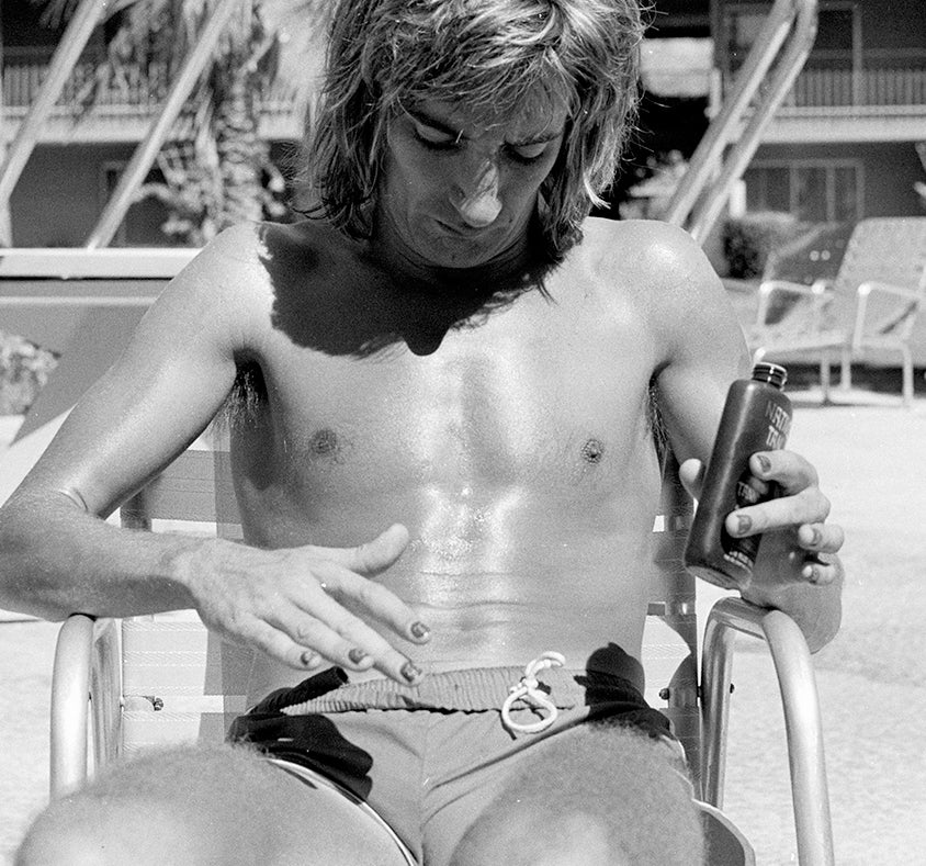 Image of Rod 'the bod' Stewart poolside in a Speedo