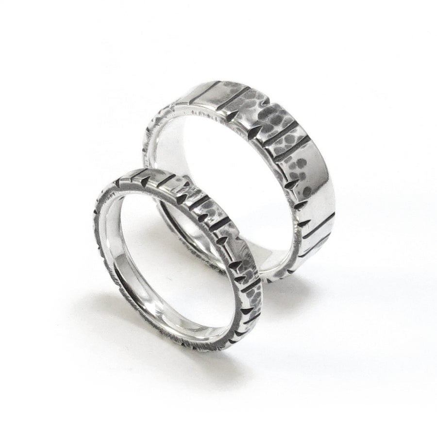 Image of Date Notched Wedding Rings