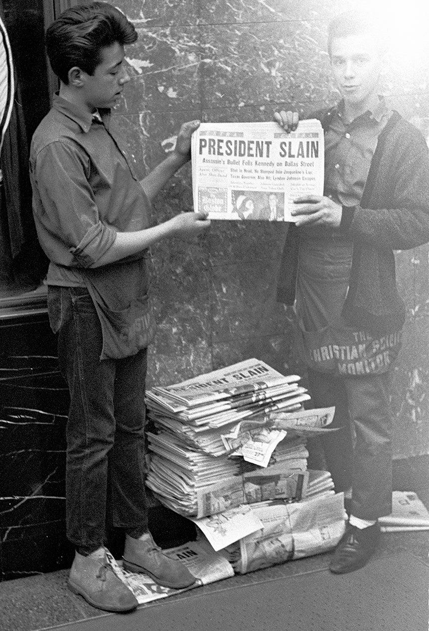Image of President Slain..  Two News Boys Show Kennedy Cover