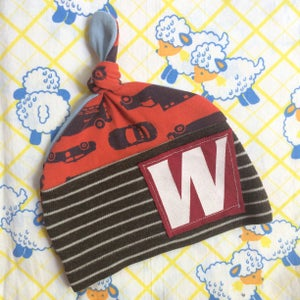 Image of custom letter knot BABY hat type typography