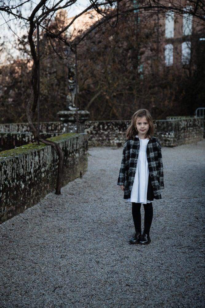 Image of Manteau noir et blanc