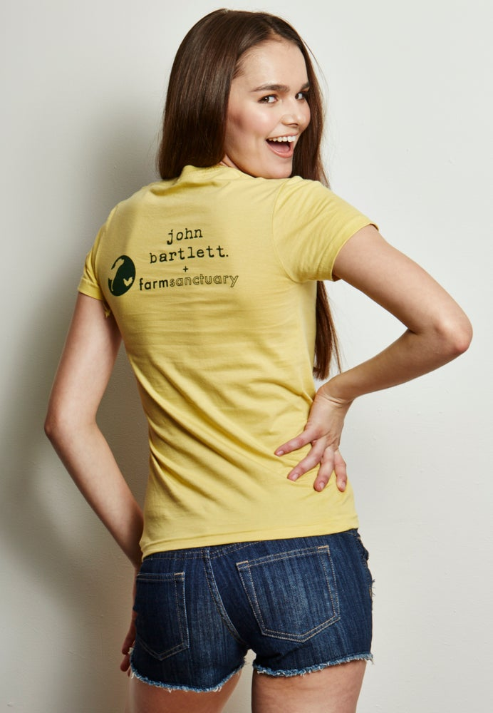 Image of girl's 100% organic cotton lemon yellow farm sanctuary chicken tee