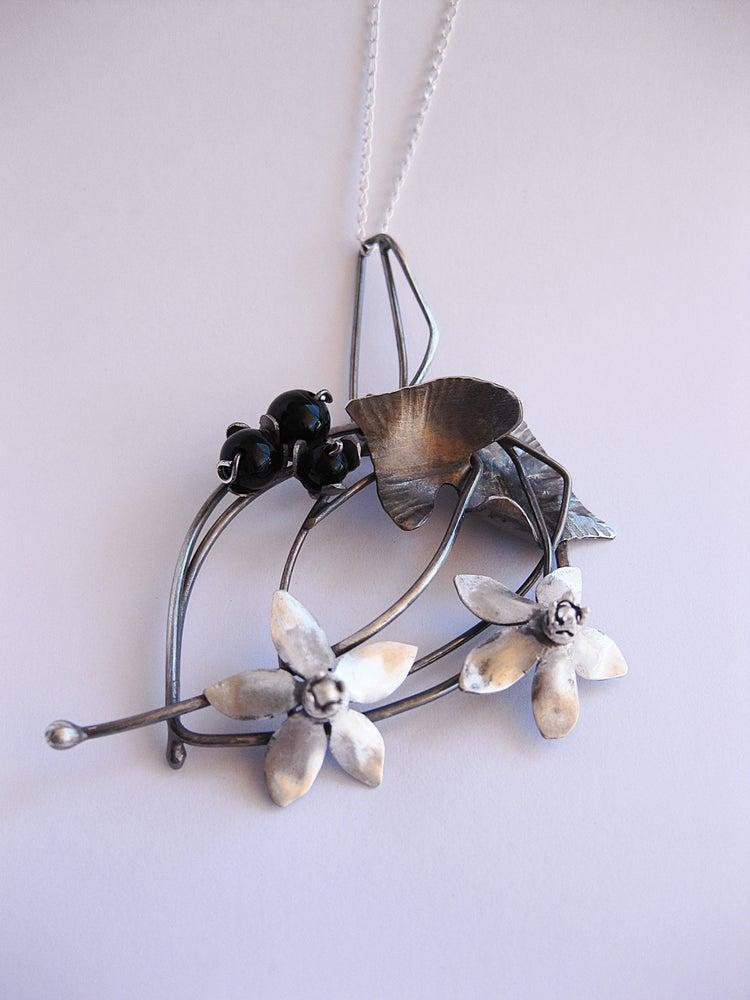 Image of Night shade wreath pendant
