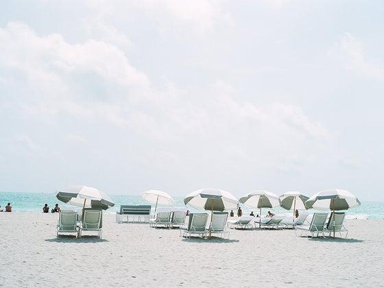 Image of beach scene and umbrellas