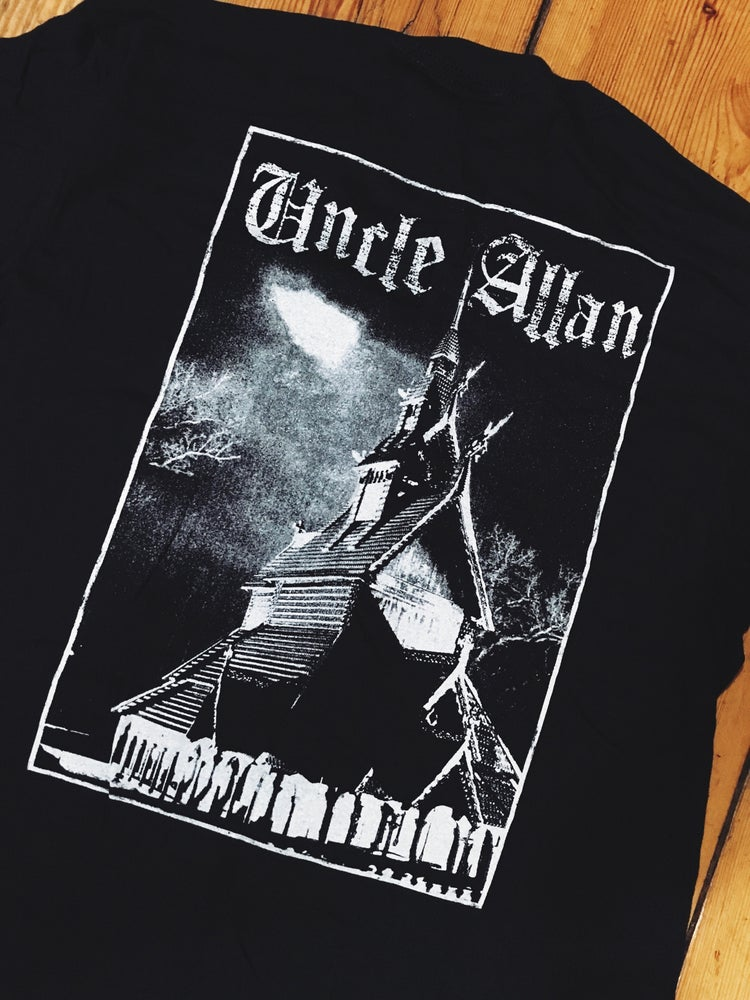 Image of Godless tattooing shirt.