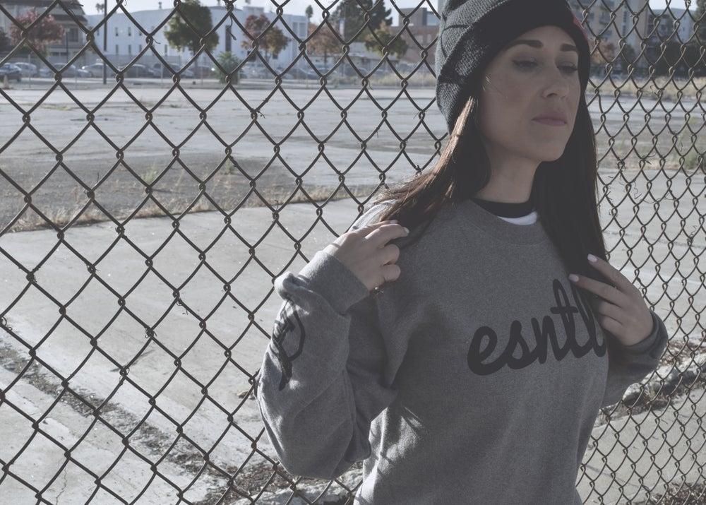 "Image of ESNTL ""Cuffin"" crew neck sweater."