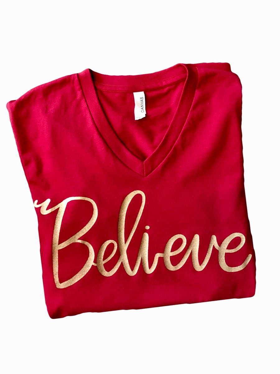 Image of BELIEVE V-Neck Tee in Red with Gold lettering