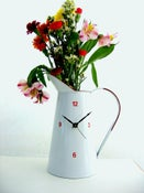 Image of White pitcher clock