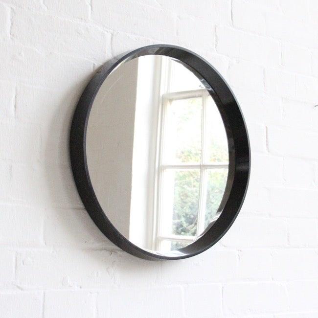 Image of Black round mirror c 1960