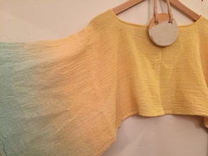 Image of buttery peachy blue Aura Crop