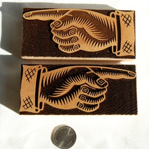 Image of A pair of 12 line UK Manicules
