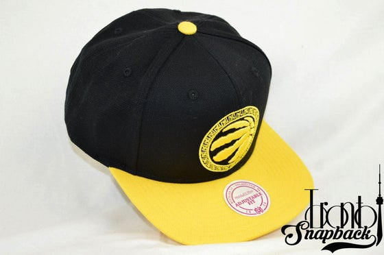 Image of TORONTO RAPTORS BLK/YEL CHINESE NEW YEAR ROOSTERS MITCHELL & NESS SNAPBACK