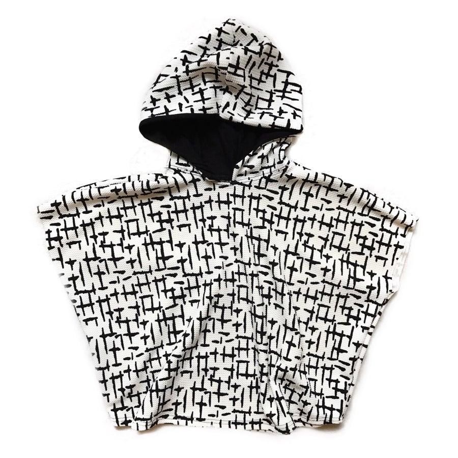 "Image of ""Hood Vibrations"" Hooded poncho |version dash|"