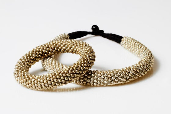 Image of gold or silver necklace +bracelet