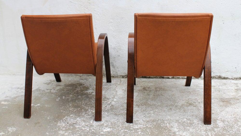 Image of Paire de fauteuils 60' bois et simili cuir