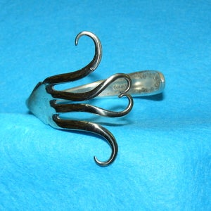 Image of forked heart bangle