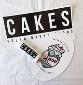 "Image of ""CAKES"" brand sticker & Lighter pack"