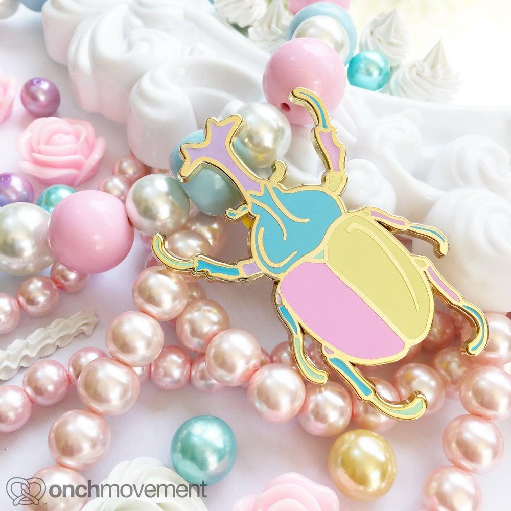 """Image of """"Babydoll"""" Unicorn Beetle Brooch"""