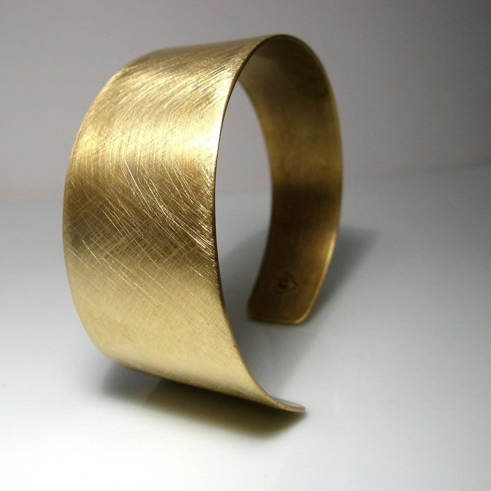 Image of asymmetrical cuff. bracelet. brass.