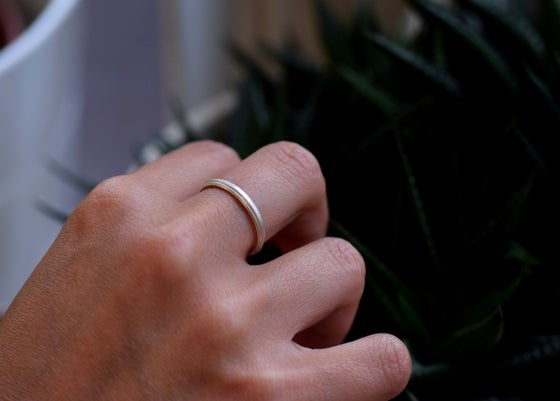 Image of Sterling Silver Round 'Strata' Ring. 2.6mm diameter rhombus shaped band
