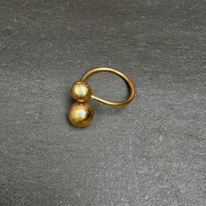 Image of Small brass planets ring