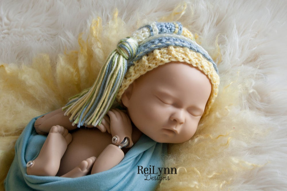 Image of Ivory, Light Country Blue, Baby Maize and Sage Tassel Hat
