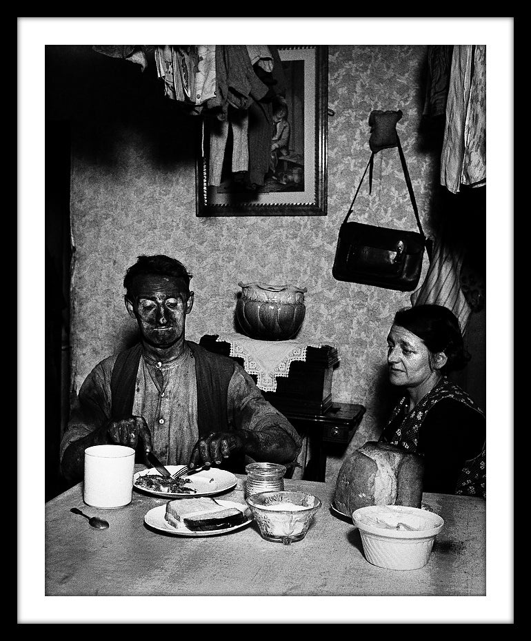 Image of SP28-Northumbrian coal miner eating his evening meal, 1937