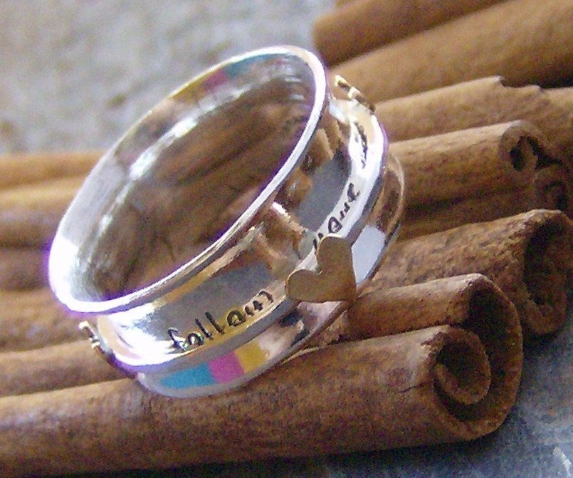 Image of follow your heart sterling and brass spinner ring